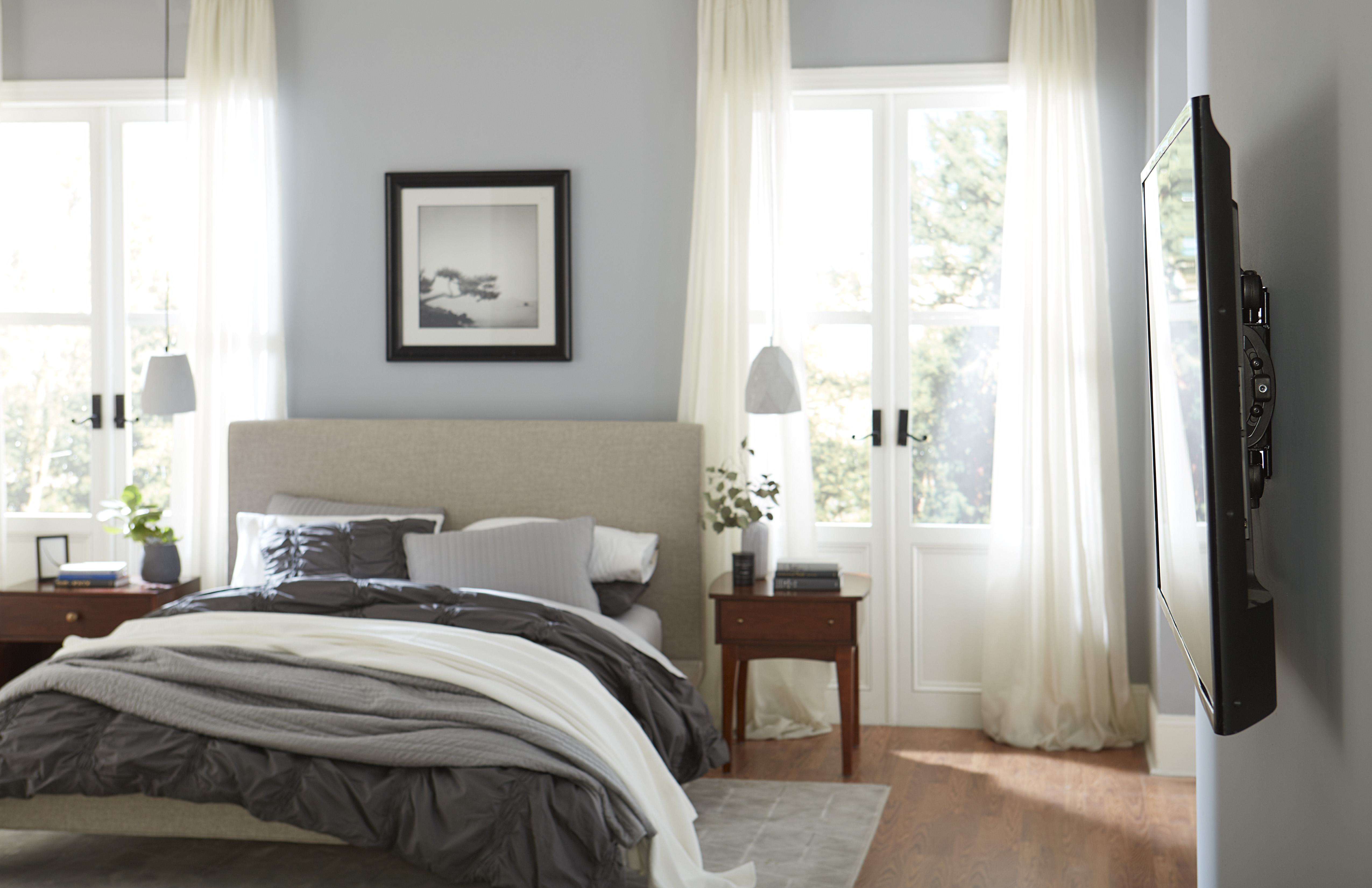 TV mounted in bedroom