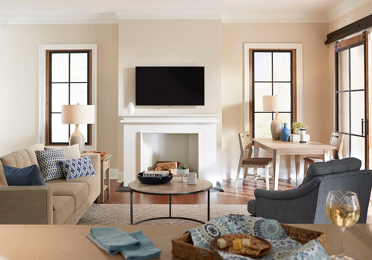 TV mounted above fireplace in open concept room