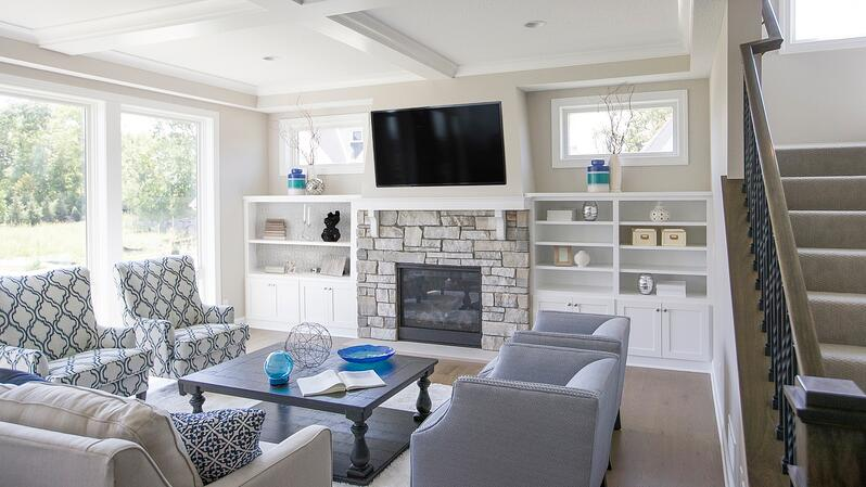 TV over fireplace in open concept floor plan