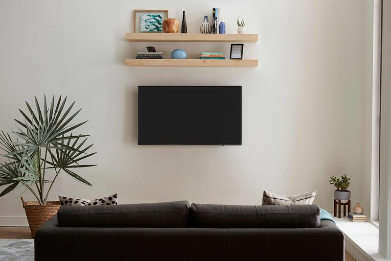 Floating Shelves Above TV