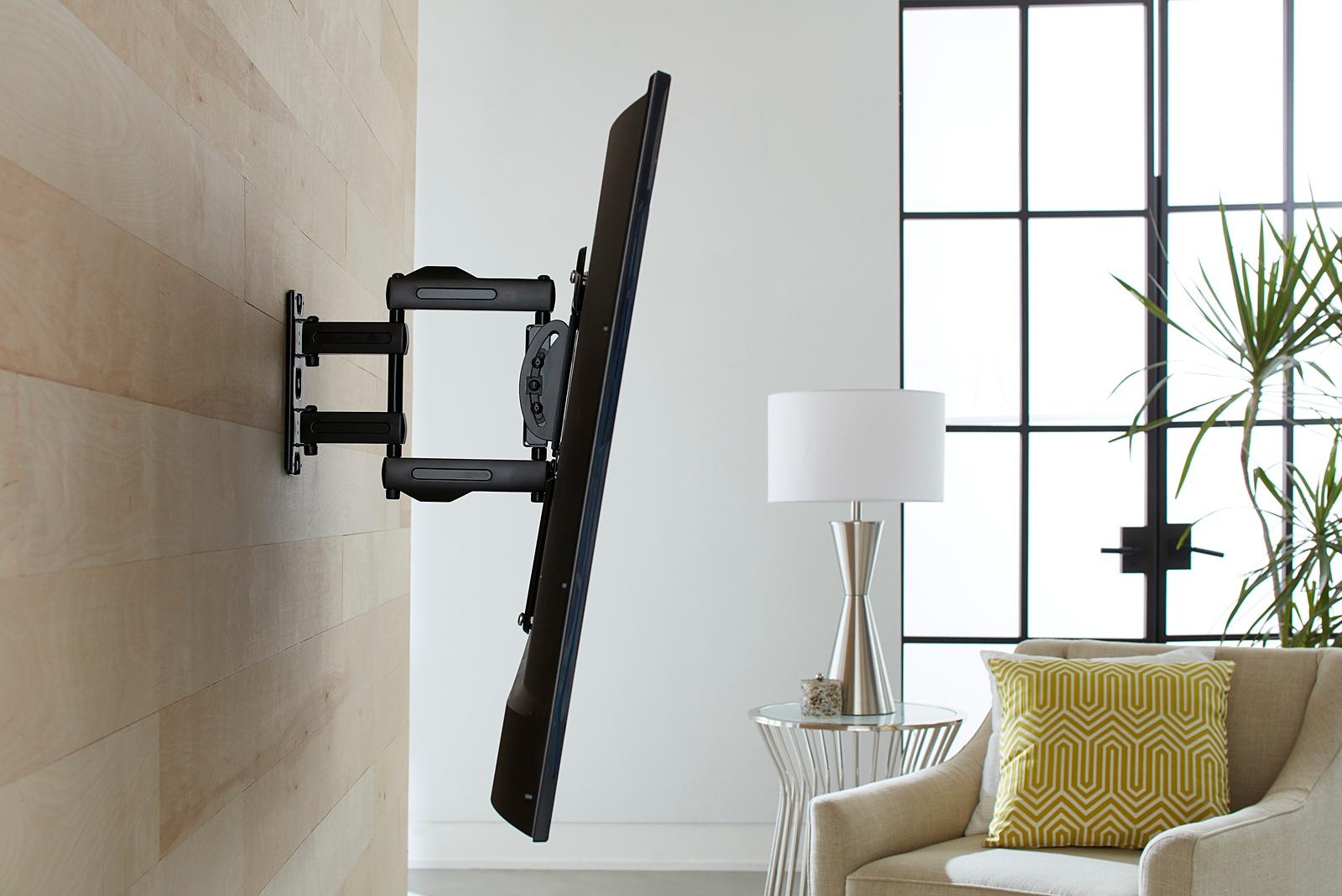 SANUS OLF15 full motion TV mount extended from wall