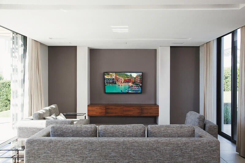floating entertainment center with mounted TV