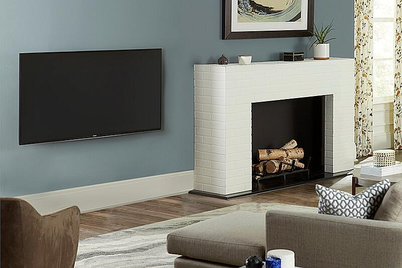 tv beside fireplace